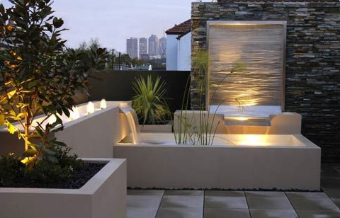 Modern rooftop patio gardens revive landscape design for Water feature design